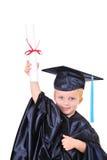 Menino novo no vestido da graduação Fotos de Stock