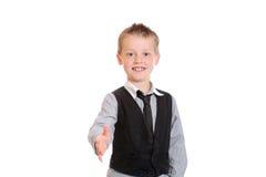 Menino novo pronto para agitar as mãos fotografia de stock royalty free