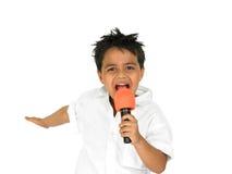 Menino novo que canta Foto de Stock Royalty Free