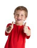 Menino novo que dá lhe os polegares acima imagens de stock royalty free