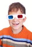 Menino novo que desgasta os vidros 3D Imagens de Stock Royalty Free