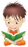 Menino novo que lê um livro Foto de Stock