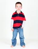Menino novo que levanta com mão no bolso Fotografia de Stock Royalty Free