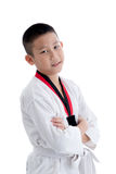 Menino novo que treina a ação de taekwondo isolada Fotos de Stock