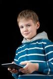 Menino novo que usa a tabuleta Imagem de Stock Royalty Free