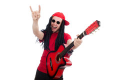 Menino positivo com a guitarra isolada no branco Foto de Stock