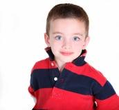 Menino pré-escolar novo no fundo branco Fotos de Stock