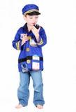 Menino pré-escolar novo no traje da polícia Fotografia de Stock Royalty Free