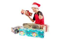 menino Pre-adolescente e uma seleção de presentes do Natal Imagens de Stock Royalty Free