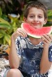 Menino que aprecia a melancia Imagem de Stock