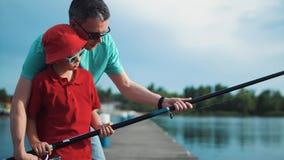 Menino que aprende como pescar Fotografia de Stock