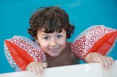 Menino que aprende nadar Foto de Stock Royalty Free