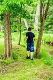 Menino que caminha o passeio afastado Fotos de Stock Royalty Free