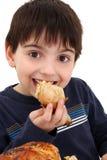 Menino que come a galinha Foto de Stock Royalty Free