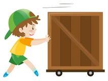 Menino que empurra a caixa de madeira apenas Imagens de Stock