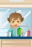 Menino que escova seus dentes Imagem de Stock Royalty Free