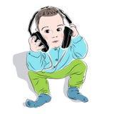 Menino que escuta a música em auscultadores Foto de Stock Royalty Free