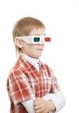 Menino que está em apontar dos vidros 3d Imagens de Stock Royalty Free