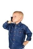 Menino que fala no telefone Imagens de Stock