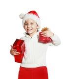 Menino que guarda caixas de presente do Natal Fotografia de Stock