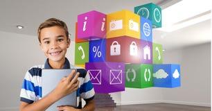 Menino que guarda a tabuleta digital com ícones da aplicação no fundo Fotografia de Stock Royalty Free