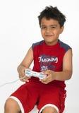 Menino que joga com vara de alegria Imagem de Stock