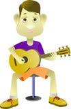 Menino que joga a guitarra com um ritmo melodioso Imagens de Stock Royalty Free