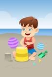 Menino que joga na praia Fotos de Stock Royalty Free