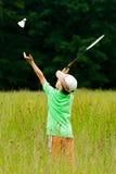 Menino que joga o badminton Imagem de Stock Royalty Free