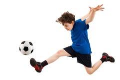 Menino que joga o futebol foto de stock royalty free