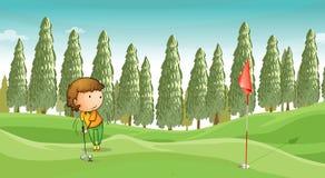 Menino que joga o golfe Imagem de Stock