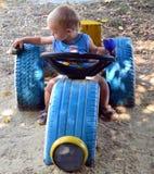 Menino que joga um brinquedo Foto de Stock Royalty Free
