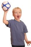 Menino que joga uma esfera Imagem de Stock