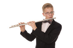 Menino que joga uma flauta Foto de Stock Royalty Free