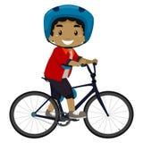 Menino que monta uma bicicleta Fotografia de Stock