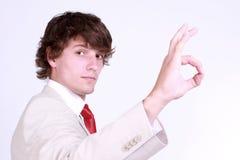 Menino que mostra o gesto Foto de Stock Royalty Free