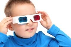 Menino que olha com vidros 3d Imagem de Stock Royalty Free
