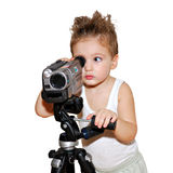 menino que olha na câmara de vídeo Fotografia de Stock