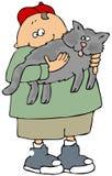 Menino que prende um gato cinzento Fotos de Stock Royalty Free