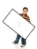 Menino que prende um sinal em branco Imagem de Stock Royalty Free