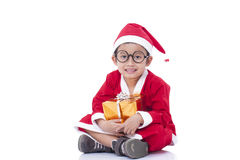 Menino que veste o uniforme de Santa Claus Fotos de Stock