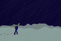 Menino só no blizzard do inverno Imagens de Stock