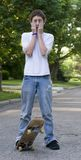 Menino Skateboarding Foto de Stock Royalty Free
