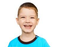 Feche acima do menino smeiling do retrato, isolado no fundo branco fotografia de stock