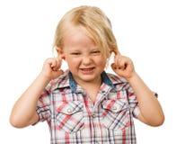 Menino triste que obstrui as orelhas Fotografia de Stock Royalty Free