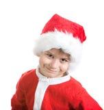 Menino vestido como Papai Noel Foto de Stock Royalty Free