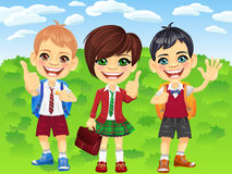 Meninos e menina de sorriso dos alunos do vetor Fotografia de Stock