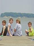 Meninos em uma doca da pesca Imagens de Stock Royalty Free