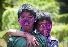 Meninos novos com as caras pintadas na Índia Foto de Stock Royalty Free