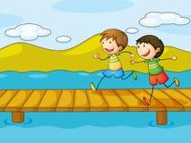 Meninos novos que jogam na ponte ilustração royalty free
